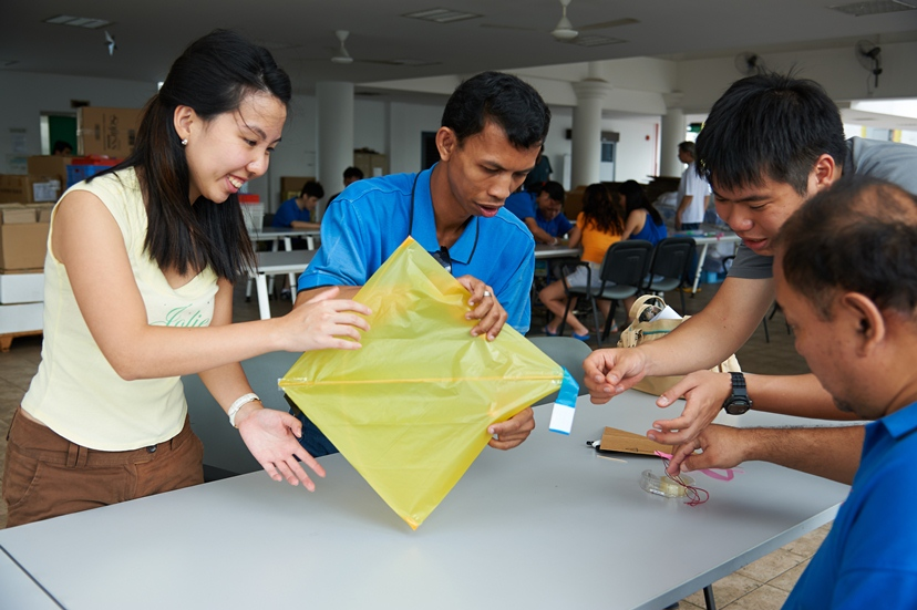 Photo of volunteers and SPD members making kite together