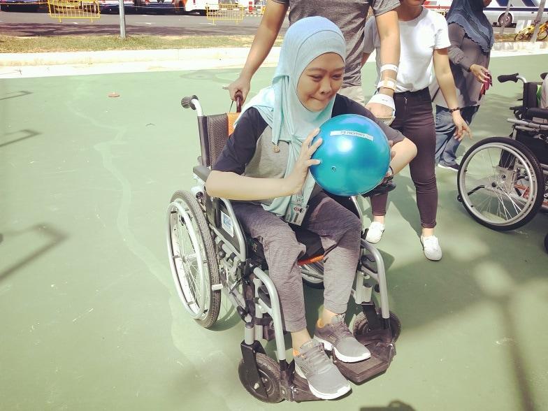 Aisha enjoying a ball game at an outing