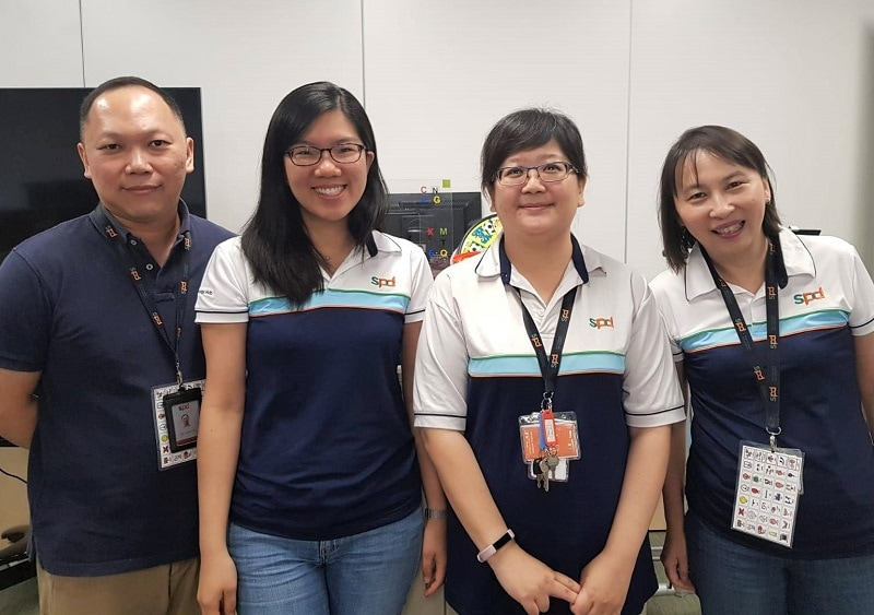 Deborah (second from left) with her colleagues from the SPD Specialised Assistive Technology Centre (Specialised ATC), who are all RESNA-certified assistive technology professionals
