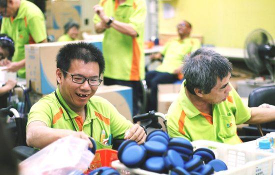 SPD Sheltered Workshop trainees assembling race packs