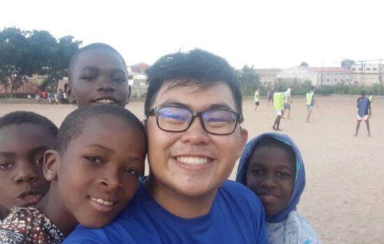 Elliot with 4 African children
