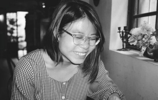 Social worker Xinyi smiling